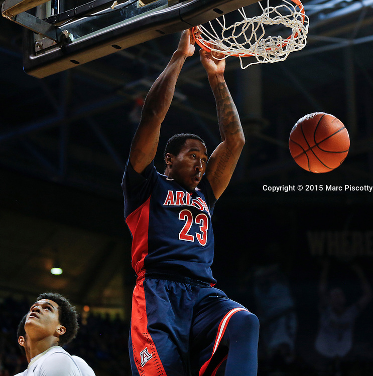 SHOT 2/26/15 8:16:21 PM - Arizona's Rondae Hollis-Jefferson #23 dunks the ball over a couple of Colorado players during their regular season Pac-12 basketball game at the Coors Events Center in Boulder, Co. Arizona won the game 82-54.<br /> (Photo by Marc Piscotty / &copy; 2015)