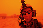 U.S. Army 3rd Division 3-7 Infantry Lieutenant Mike Washburn from Yorktown, Virginia is seen during a sand storm that has halted his unit's push to Baghdad near the Iraqi city of Najaf  March 26, 2003. The 3rd Infantry Division pushed north into Iraq despite a week of hindering sandstorms and guerilla attacks by militias loyal to Iraqi President Saddam Hussein that frustrated commanders and disrupted supply lines.