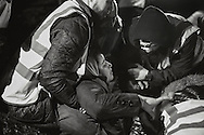 Rescue workers pull an unconscious migrant woman off a boat after the crossing of the Aegean Sea. Lesbos, March 20, 2016