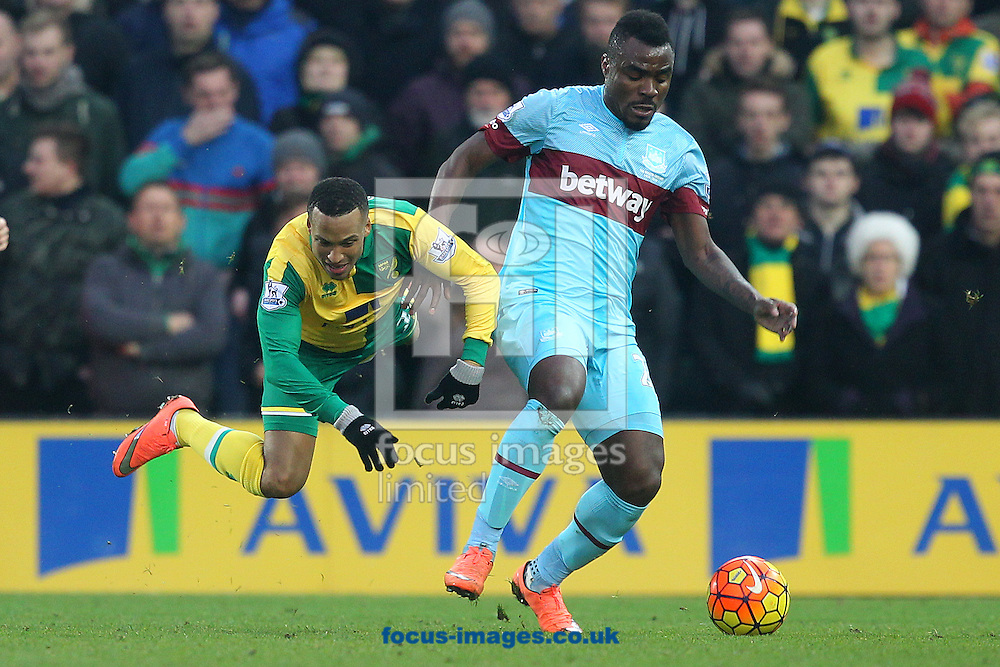 Martin Olsson of Norwich and Michail Antonio of West Ham in action during the Barclays Premier League match at Carrow Road, Norwich<br /> Picture by Paul Chesterton/Focus Images Ltd +44 7904 640267<br /> 13/02/2016