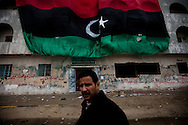 A man during friday prayers in the square in Benghazi. Open prayer was banned as was attending mosques during Qadaffi's rule on March 4, 2011.