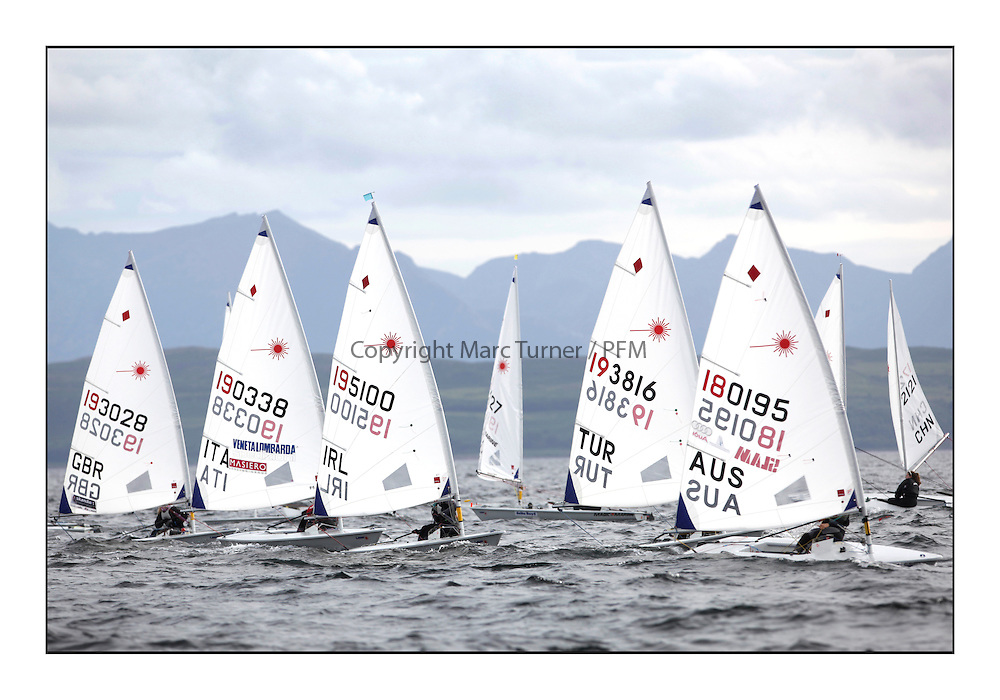 Fleet rounding gate mark on leg 5 including, Chloe Martin, GBR 193028, Laura Marimon Giovannetti, ITA 190581, Debbie Hanna, IRL 195100, Pinar Kaynar, TUR 193816 and Krystal Weir, AUS 180195..Day 3 started late after strong winds postponed racing till 5pm for the Laser Radial World Championships, taking place at Largs, Scotland GBR. ..118 Women from 35 different nations compete in the Olympic Women's Laser Radial fleet and 104 Men from 30 different nations. .All three 2008 Women's Laser Radial Olympic Medallists are competing. .The Laser Radial World Championships take place every year. This is the first time they have been held in Scotland and are part of the initiaitve to bring key world class events to Britain in the lead up to the 2012 Olympic Games. .The Laser is the world's most popular singlehanded sailing dinghy and is sailed and raced worldwide. ..Further media information from .laserworlds@gmail.com.event press officer mobile +44 7775 671973  and +44 1475 675129 .