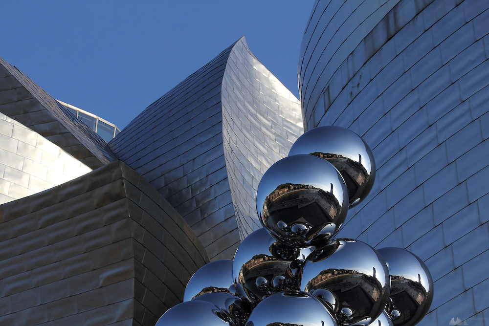 "Indian Sculptor Anish Kapoor's ""Tall Tree & The Eye"" sculpture sits on a plinth outside the Guggenheim Museum in Bilbao"