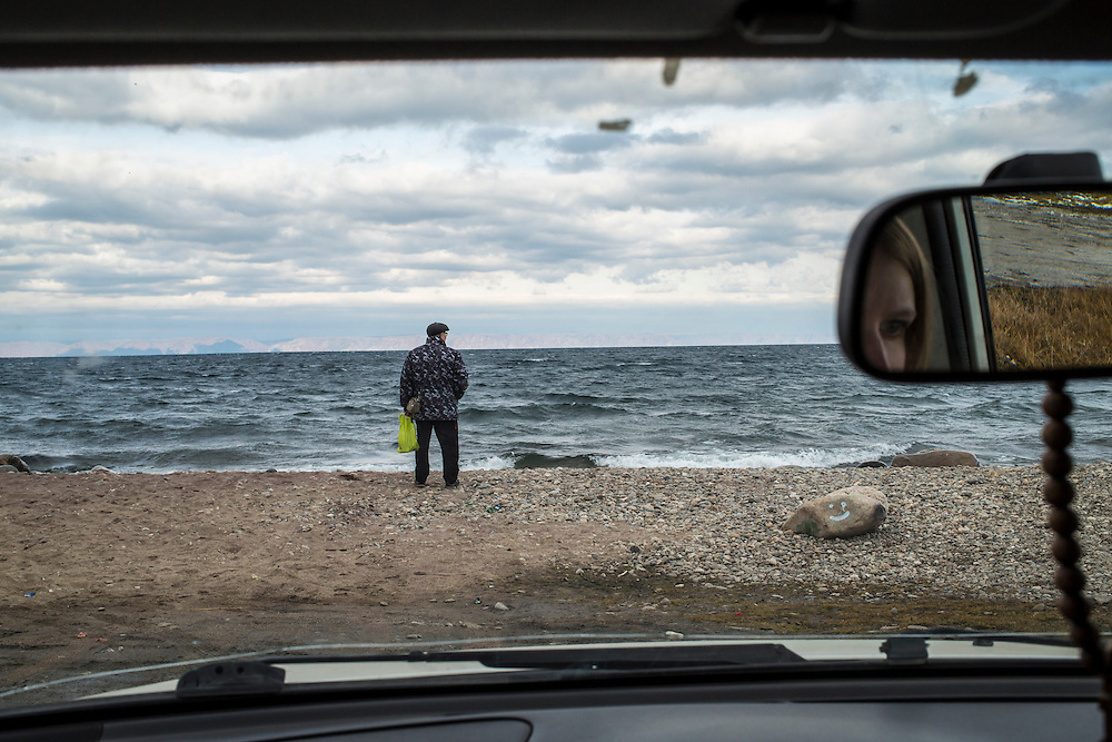 A man stands on the shore of Lake Baikal on Sunday, October 20, 2013 in Baikalsk, Russia.