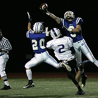 Hilliard Davidson's Adam Frazier (9) and Nick VanDyne (20) break up a Worthington Kilbourne pass intended for Alan Tobey (2) in the second quarter Saturday November 8, 2008.