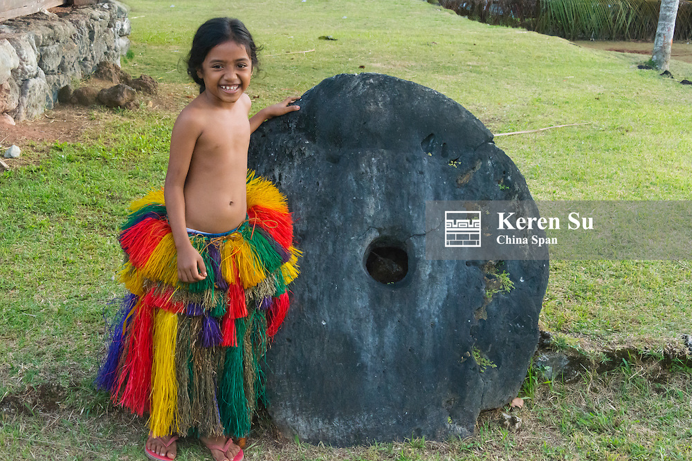 Yapese girl in traditional clothing with stone money at Yap Day Festival, Yap Island, Federated States of Micronesia