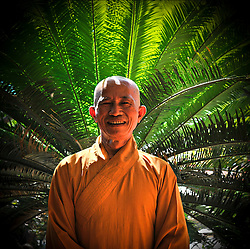 Portrait of a cheerful buddhist monk in Khanh Hoa province, Vietnam, Southeast Asia