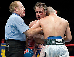 June 10, 2006 - New York, NY - Paulie Malignaggi  grimaces while in a clinch with WBO Champion Miguel Cotto during their 12 round Junior Welterweight Championship bout at Madison Square Garden.  Cotto retained his title via 12 round unanimous decision.