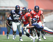 Maikhail Miller (9) is chased by Trae Elson (7) at Ole Miss' Grove Bowl at Vaught-Hemingway Stadium in Oxford, Miss. on Saturday, April 13, 2013.