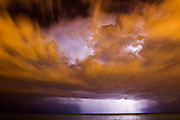 Low-level clouds frame a towering cumulonimbus cloud during a severe thunderstorm over Lake Michigan in this view from Chicago, Illinois.