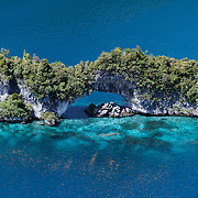 Aerial view of the Natural Arch formation in the Rock Islands of Palau.