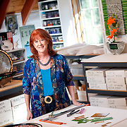 SHOT 8/31/11 10:57:13 AM - Artist Trudy Evard Chiddix poses for a portrait in the studio out back of her home in Evergreen, Co. Her work is inspired by the art of ancient civilizations, by folk crafts of many cultures, and by patterns and textures found in nature and while traveling. Her primary medium is clay, but she often incorporates fused glass and mixed media into her vessels, sculptures and wall hangings. (Photo by Marc Piscotty /  © 2011)