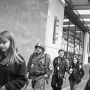 2017 MARCH 05 - People walk up Pine St near Emerald City Comicon, downtown, Seattle, WA, USA. By Richard Walker