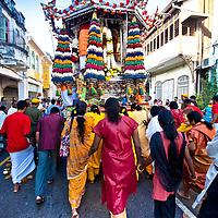 Women following the Siver Chariot on the route to the Nattukotai Chettiar Temple.