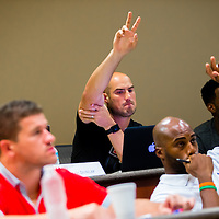 MIAMI, FL - June 24, 2015 -- NFL quarterback Mike Kafka raises his hand as he participates in a Legal & Ethical Implications of Executive Decision Making class taught by Professor Patricia Abril at the University of Miami as part of their Miami Executive MBA for Artists & Athletes program on Wednesday, June 24, 2015.  (PHOTO / CHIP LITHERLAND)