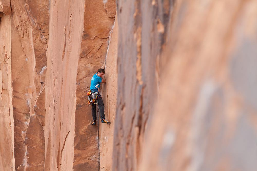 Alastair Mcdowell climbing Astro lad, 5.11a at Wallstreet, Moab, Utah