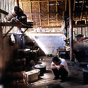 """Man who was blinded during the fighting between the Karen liberation army that he was fighting with and the Burmese army troups, in the kitchen of the disabled people's home inside Mae La. Burmese refugee camp """"Mae La"""" is north of border-town Mae Sot and lies along the Thai-Burmese border on the side of Thailand. Approximately 50,000 people live there. 38,167 was the official number of registered people in November 2009, according to the Thailand Burma Border Consortium (TBBC), and the rest are unregistered or people who come and go."""