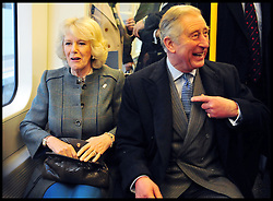 Prince Charles and The Duchess of Cornwall ride on a Tube Train on London's Underground from Farringdon to Kings Cross, Wednesday January 30, 2013, to celebrate 150 Years of the London Underground. Photo By Andrew Parsons / i-Images