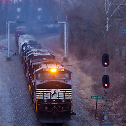 Heading onto the single track north of Kings Mountain, KY, a northbound Norfolk Southern freight cuts through a gathering late evening rainstorm.