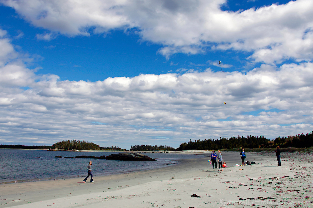 North America, Canada, Nova Scotia, Eastern Shore. Kite Flying on beach at Taylor Head Provinicial Park.