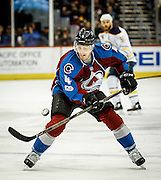 SHOT 2/25/17 9:16:53 PM - The Colorado Avalanche's Tyson Barrie #4 tries to corral a bouncing puck while playing against the Buffalo Sabres during their NHL regular season game at the Pepsi Center in Denver, Co. The Avalanche won the game 5-3. (Photo by Marc Piscotty / © 2017)