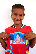 Boy with his baby picture near Belic, Granma, Cuba.