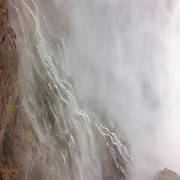 Mist from Snoqualmie Falls during a particularly heavy flow drifts and forms a secondary waterfall. The 268 foot (82 meter) waterfall is located between the cities of Fall City and Snoqualmie, Washington.