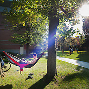 A student takes a load off between classes to study.<br />