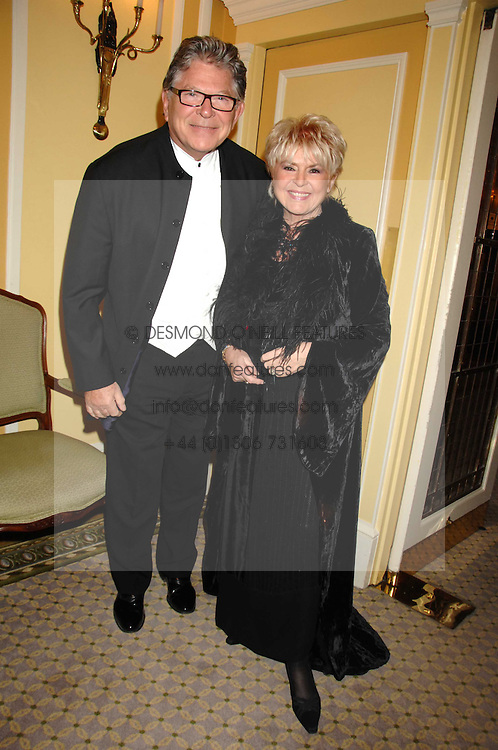 TV presenter GLORIA HUNNIFORD and her husband STEPHEN WAY at the Chain of Hope Ball held at The Dorchester, Park Lane, London on 4th February 2008.<br />
