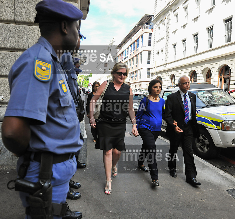 CAPE TOWN, SOUTH AFRICA - Monday 13 October 2014, Snila and Prakash Dewani, parents of Shrien Dewani, arrives at court walking past members of the police outside during Day 4 of the Shrien Dewani trial at the Cape High Court before Judge Jeanette Traverso. Dewani is caused of hiring hit men to murder his wife, Anni. Anni Ninna Dewani (n&eacute;e Hindocha; 12 March 1982 &ndash; 13 November 2010) was a Swedish woman who, while on her honeymoon in South Africa, was kidnapped and then murdered in Gugulethu township near Cape Town on 13 November 2010 (wikipedia).<br /> Photo by Roger Sedres