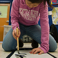 12/14/10 Middletown DE: Japanese instructor Anna Ebina (17) demonstrate the art of Japanese brush calligraphy at Middletown High school In Middletown Delaware...Special to The News Journal/SAQUAN STIMPSON