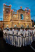 The Navy provide a cordon around the vehicle which will carry the statue of St. Anthony around the neighborhood. Kochchikade, Colombo 13. Last day of the annual feast and festival.