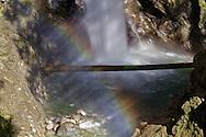 Rainbow under Cascade Falls in Cascade Falls Regional Park near Mission, British Columbia, Canada