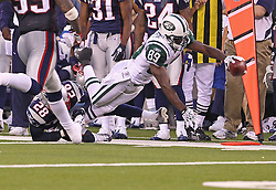Sept 19, 2011; East Rutherford, NJ, USA; New York Jets wide receiver Jerricho Cotchery (89) dives for the first down marker past New England Patriots cornerback Darius Butler (28) during the 2nd half at the New Meadowlands Stadium.  The Jets defeated the Patriots 28-14.