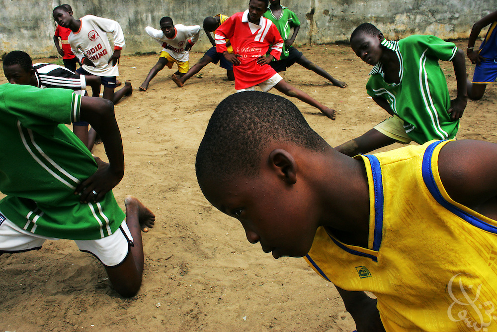 Ivorian boys train at the Olympic Sport Abobo club in the Abobo neighborhood of Abidjan, Côte d'Ivoire February 18, 2006. Motivated by the success of the national team, and Ivorian footballers in European leagues, Ivorian boys and their parents often view football as their only chance to escape poverty within their communities.