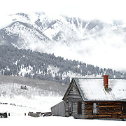 """SHOT 2/12/12 1:39:03 PM - A small homestead near Crested Butte, Co. Crested Butte is a Home Rule Municipality in Gunnison County, Colorado, United States. A former coal mining town now called """"the last great Colorado ski town"""", Crested Butte is a destination for skiing, mountain biking, and a variety of other outdoor activities. The population was 1,529 at the 2000 census. The Colorado General Assembly has designated Crested Butte the wildflower capital of Colorado. The primary winter activity in Crested Butte is skiing or snowboarding at nearby Crested Butte Mountain Resort in Mount Crested Butte, Colorado. Backcountry skiing in the surrounding mountains is some of the best in Colorado. The mountain, Crested Butte, rises to 12,162 feet (3,700 m) above sea level..(Photo by Marc Piscotty / © 2012)"""
