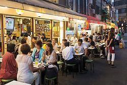 Small outdoor restaurants on street in the evening in Rokku entertainment district of Asakusa adjacent to SensoJi shrine in Tokyo Japan