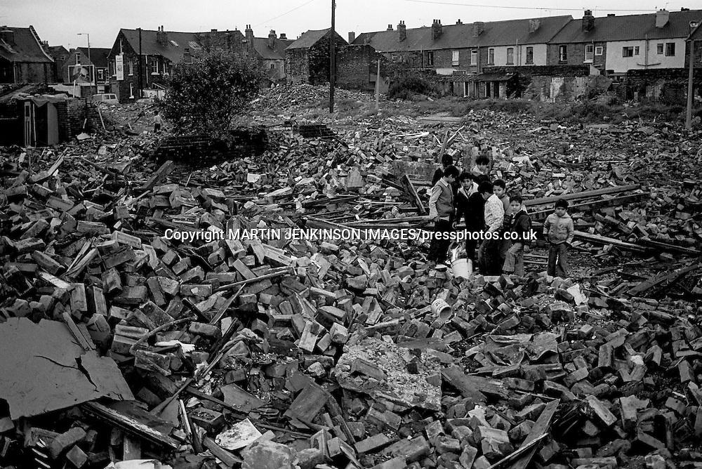 Children amongst the rubble of demolished houses. Darnall Sheffield 21/08/1982