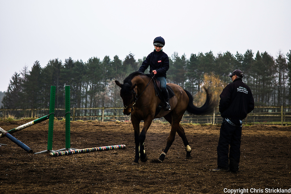 4 Star eventer Emily Galbraith schools horses on a cold, wet, and foggy day in the Scottish Borders, in preparation for the upcoming eventing season.
