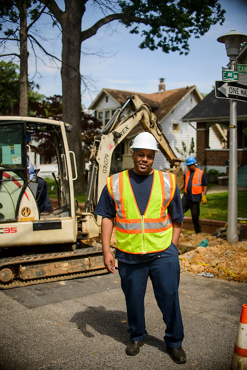 Photo by Matt Roth<br /> <br /> Baltimore City Department of Public Works acting division chief of utility maintenance Anthony Galloway, stands in front of a a fire hydrant work site at the intersection of Tyndale Ave., and Canfield Ave. in Baltimore, Maryland on Wednesday, May 29, 2013.