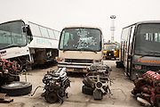 Busses and motors waiting for recycling at Dinko Valev's junkyard in Yambol, Bulgaria. The shot-up windshield was done for fun by workers at the yard after the bus arrived.<br /> <br /> Matt Lutton / Boreal Collective for VICE