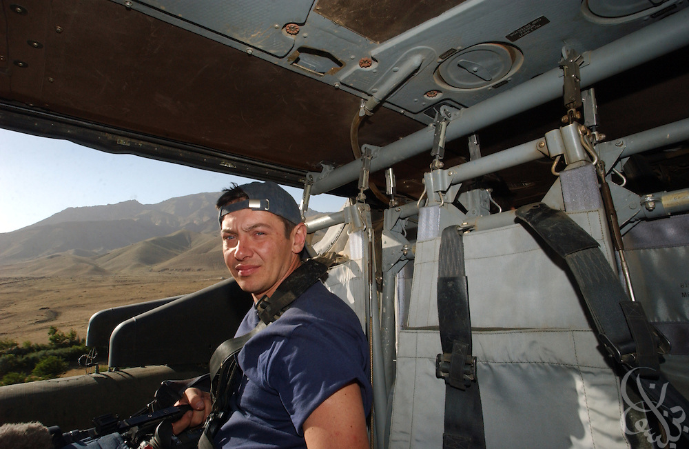 Reuters television cameraman Taras Protsyuk is seen aboard a U.S. Army UH-60 Black Hawk helicopter as he covers a June 17, 2002 U.S. Army mission across the remote Baba mountains near Bamiyan, Afghanistan. Protsyuk, age 35,  was killed April 8, 2003 during the U.S. lead invasion of Iraq when a U.S. tank mistakenly targeted the Palestine Hotel in Baghdad, hitting the balconies where he and other journalists were filming the invasion.