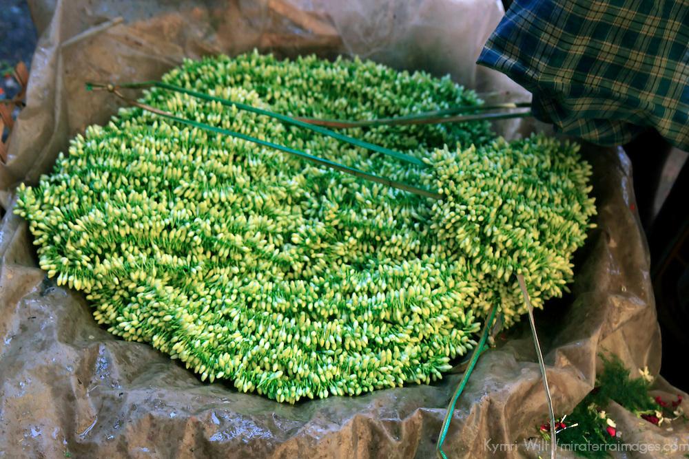 Asia, India, Calcutta. SGarlands of Freesia buds in the flower market in Calcutta.