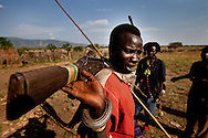 Young warriors carry guns to protect their communities and for cattle raids on other tribes.