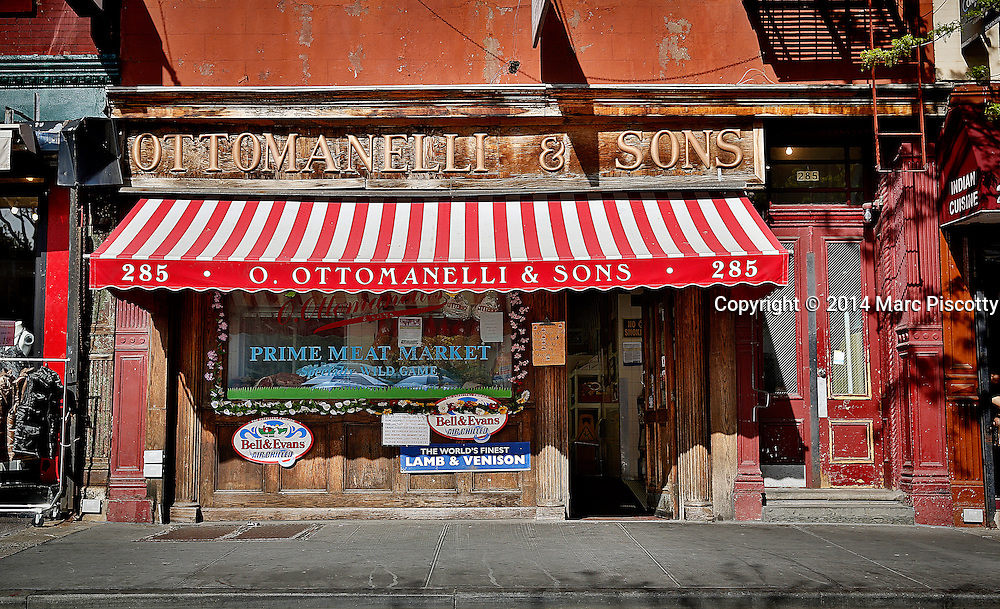 SHOT 5/5/14 2:42:23 PM - Ottomanelli & Sons Meat Market an Italian butcher with a funky old-world vibe selling steaks, housemade sausage & wild game in the West Village in New York City, N.Y. New York is the most populous city in the United States and the center of one of the most populous urban agglomerations in the world—the New York metropolitan area. The city is referred to as New York City or the City of New York to distinguish it from the State of New York, of which it is a part. A global power city, New York exerts a significant impact upon commerce, finance, media, art, fashion, research, technology, education, and entertainment. New York City has often been described as the cultural and financial capital of the world. (Photo by Marc Piscotty / © 2014)