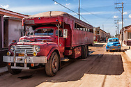 Truck and car in Guira de Melena, Artemisa Province, Cuba.