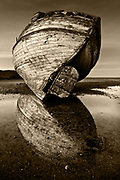 Nominated for 11th International B&amp;W Spider Awards<br /> <br /> One of two fishing boats which have been left to deteriorate in the Dulas Estuary in East Anglesey. As the estuary is relatively well protected from the open sea, the wrecks have hardly moved in many years, but are very gradually looking more broken