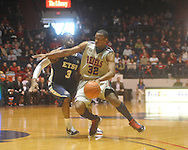 "Ole Miss guard Zach Graham (32)  dribbles against East Tennessee State's Justin Tubbs (3) at the C.M. ""Tad"" Smith Coliseum in Oxford, Miss. on Saturday, December 18, 2010. Ole Miss won 71-50."