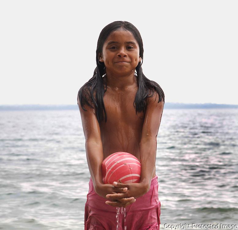 Mayan child in Guatemala playing by the lake.