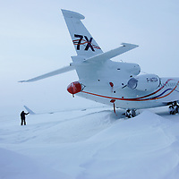 Cold soak trial in Arctic Canada.  Falcon 7X in Resolute Bay, Nunavut,  the day after blizzard when wind gusts of 60 kmh almost stranded the aircraft in the snow. April 2006. © Etienne de Malglaive.